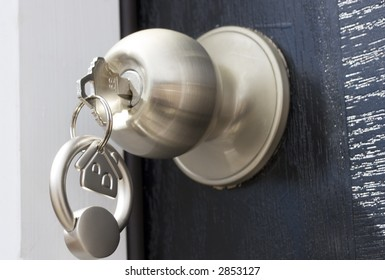 Key On A Keychain In The Lock Of A Front Door