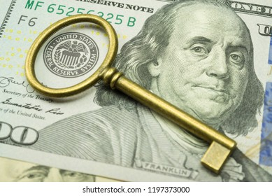 Key on US dollars banknote near Federal Reserve System (FED) seal. Concept of control economy financial crises in world and USA. Central banking system of USA (FED) consider suitable interest rate.