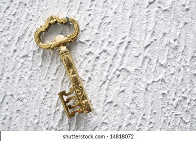 Key on the white wall