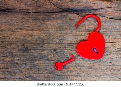 Key open lock red heart on wood background, love valentine concept, flat lay photo