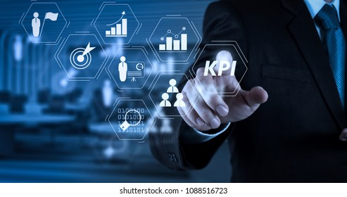 Key Performance Indicator (KPI) workinng with Business Intelligence (BI) metrics to measure achievement and planned target.Businessman hand pressing an imaginary button on virtual screen.