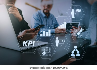 Key Performance Indicator (KPI) workinng with Business Intelligence (BI) metrics to measure achievement and planned target.co working team meeting concept,businessman using smart phone.