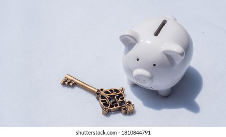 Key and piggy bank on white background with copy space, saving money is key to susses in business and life concept - Shutterstock ID 1810844791