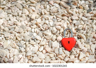 Key red hearts on a small white stone, the concepts of love and Valentine's day.