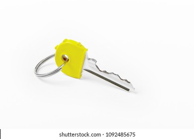 Key ring with key over white background. Rent, buy