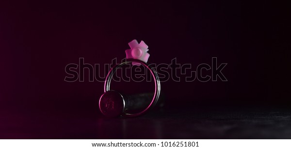 Key ring with a white object on top unique isolated object stock photograph