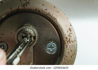 A key in a rusty keyhole.