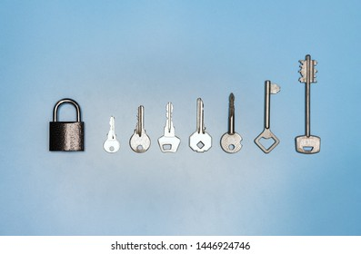 Key set concept. Lock and different antique and new keys, blue background. Protection of business and house, real estate security.