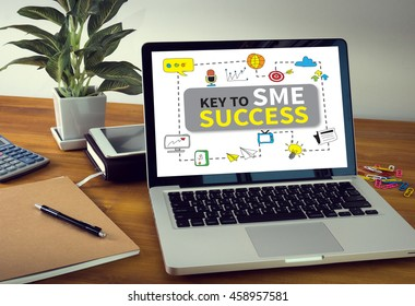 KEY TO SME SUCCESS  Small and medium-sized enterprises Laptop on table. Warm tone