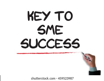KEY TO SME SUCCESS  Small and medium-sized enterprises businessman work on white broad, top view