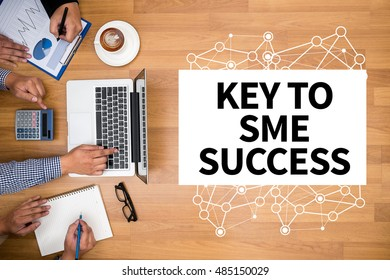 KEY TO SME SUCCESS  Small and medium-sized enterprises Business team hands at work with financial reports and a laptop