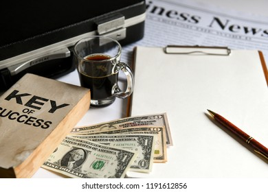 Key of success with notbook , briefcase