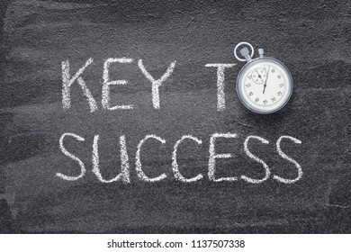 key to success phrase written on chalkboard with vintage stopwatch used instead of O