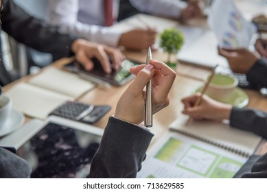 Key to success, Woman's hand  holding a pen to taking notes at a business meeting for personal reference, while meeting minutes are for official record-keeping purposes.