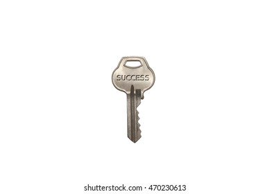 "Key to Success - Key with the word ""Success"" engraved on it."