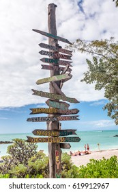Key West beach distance signs to worldwide landmarks in Fort Zachary Taylor Park - Florida, USA .