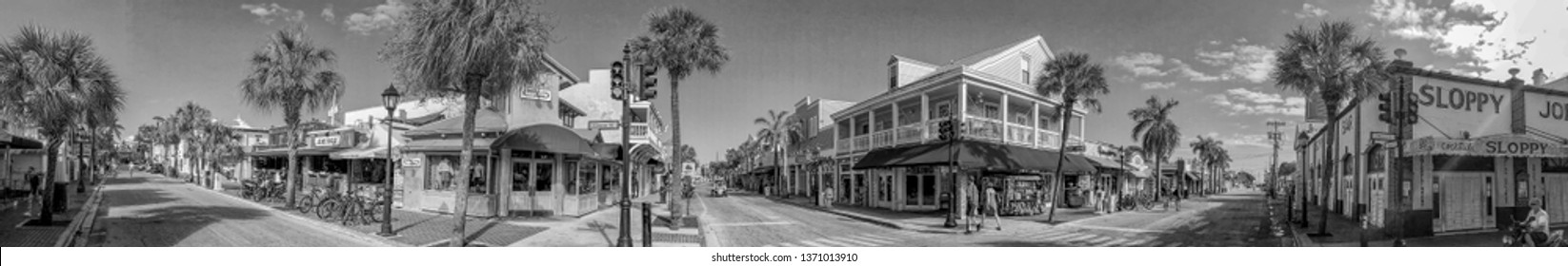 KEY WEST, FL - FEBRUARY 2016: Tourists along city streets, panoramic view. Key West is a major tourist destination in Florida.