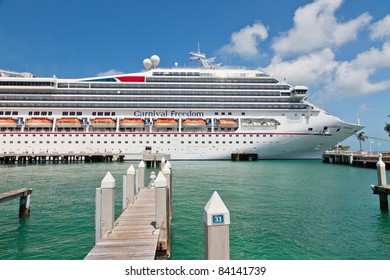 KEY WEST, FL - JULY 11: Carnival Freedom arrives in Key West, FL on July 11, 2011. Over 660,000 cruise ship passengers visit Key West every year to enjoy galleries, shops, and famous bar and grills.