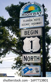 Key West, FL / USA - April 4, 2020: The southernmost point in the United States, sun drenched Key West in Florida has many colorful road signs and geographical markers trumpeting its location.