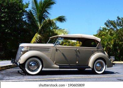 KEY WEST, FL-APRIL 27: A beige 1936 Ford Touring Phaeton Convertible Sedan automobile, side view, in parking lot in Key West, Florida on April 27, 2014.