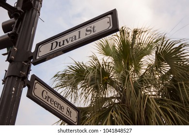 Key West, Florida - April 15 2010: The street signs of Duval and Greene Street. Duval is the main street in historic center..