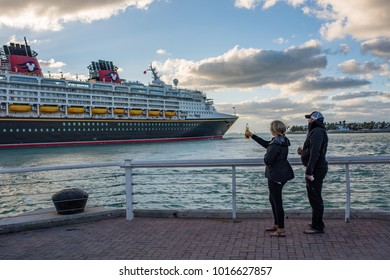 Key West, Florida: December 10, 2017:  Walt Disney Cruise line ship departing in Key West, Florida.  Walt Disney Company operates four different cruise lines for its guests.