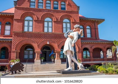 "Key West, Florida: December 10, 2017: ""Embracing Peace"" statue in Key West at Custom House Museum, which celebrates the iconic photo of a sailor and a woman kissing after World War II ended."