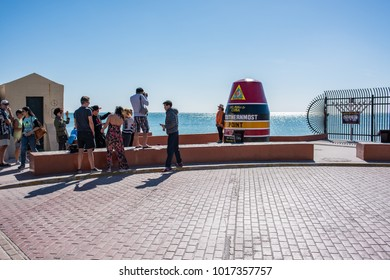 Key West, Florida: December 10, 2017: Tourists at the Southernmost Point in the Continental United States landmark.  Key West is a popular tourist destination in Florida.