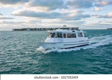 Key West, Florida: December 11, 2017: Boat in the Key West area at sun down.  Key West is a popular tourist destination in Florida.