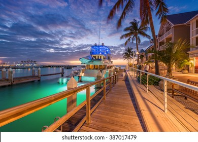 KEY WEST, FLORIDA - JANUARY 12, 2016: Yacht anchored at night in city port. Key West is a famous tourist attraction in Florida.