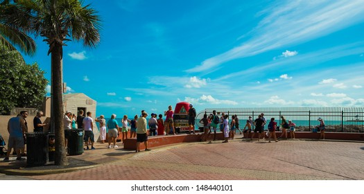 KEY WEST, FLORIDA JULY 25: Visitors in line to photograph the popular Southernmost Point on July 25, 2011 in Key West.