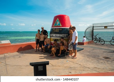 KEY WEST, FLORIDA JULY 25: Visitors being photographed at the popular Southernmost Point on July 25, 2011 in Key West.