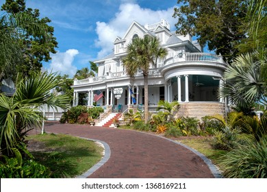 KEY WEST, FLORIDA - MARCH 13: Amsterdam's Curry Mansion Inn front view with brick driveway and palm trees, March 13, 2019 in Key West, Florida.