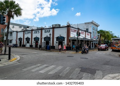 """Key West, Florida - May 2019: Tourist walk by Sloppy Joe's Bar on Duval Street in Key West, Florida."