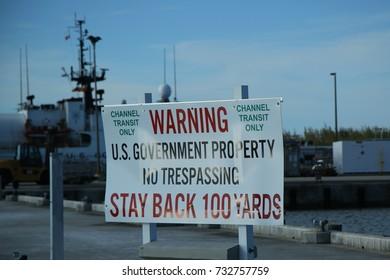 KEY WEST, FLORIDA - MAY 31, 2016: Warning sign near Navy installation at Conch Harbor Marina in Key West, Florida