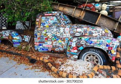 KEY WEST, FLORIDA, USA - 08 October, 2014: Old car covered with a variety of stickers at Bo's Fish Wagon restaurant in Key West, Florida, USA on 08 October, 2014.
