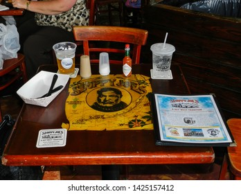 KEY WEST, FLORIDA, USA - APRIL 10, 2013: Sloppy Joe's Bar interior. Its a historic American bar, which was very frequented and sponsored by Ernest Hemingway. It is a famous tourist attraction.