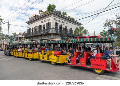 Key West, Florida, USA; Dec 18th 2018: Tourists on the Key West Conch Train on the famous Duval Street