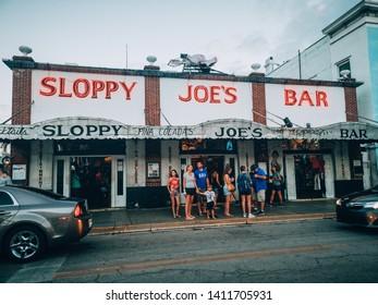 Key West, Florida, USA - January 1, 2019: American popular landmark famous touristic place Sloppy Joe's Bar on Duval street. Downtown of Old Key West.
