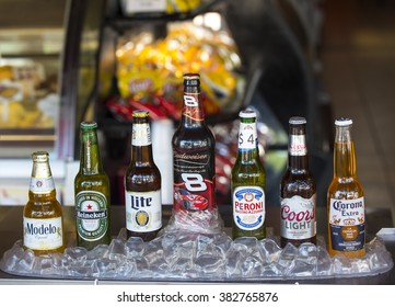 Key West, Florida, USA - January 09, 2016: Popular seven bottles of assorted cold beers in ice including Modelo, Heiniken, Lite, Budweiser, Peroni, Coors Light and Corona Extra, horizontal picture