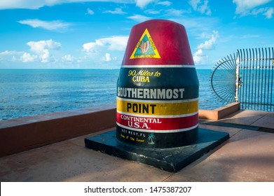 KEY WEST, FLORIDA, USA - JULY 27, 2019: A brightly painted buoy marking the southernmost point in the continental US was refurbished after hurricane damage in 2017.