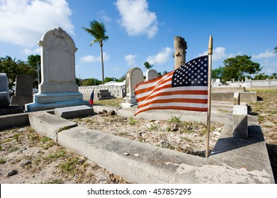 KEY WEST, FLORIDA, USA - MAY 02, 2016: American flag on a grave at the The Key West cemetery.