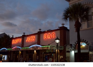 KEY WEST, FLORIDA / USA - OCTOBER 7, 2016: Sloppy Joe's Bar exterior on Duval Street, neon sign, sunset, early evening.