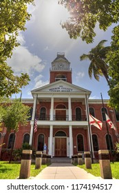 Key West, Florida, USA - September 1, 2018: Monroe County Courthouse with a Large Kapok tree Ceiba pentandra, also called the Ceiba tree, growing in front in Key West, Florida