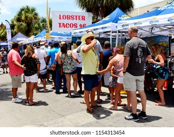 KEY WEST, FLORIDA, USA-AUGUST 11, 2018:  People celebrate the Florida Spiny Lobster at the Key West Lobster Festival, in Old Town Key West, on Saturday, August 11, 2018.  This is an annual event.