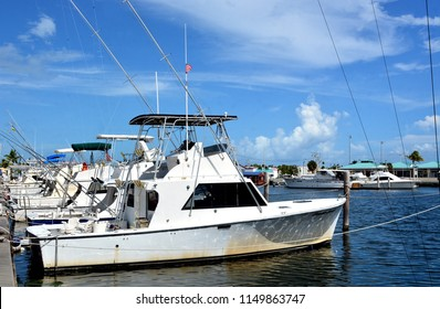 KEY WEST, FLORIDA, USA-AUGUST 4, 2018:  Sportfishing charter boats docked at the famous Charter Boat Row marina located in Key West, Florida, on August 4, 2018.