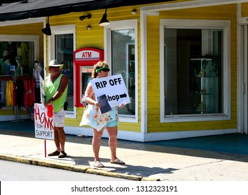 KEY WEST, FLORIDA, USA-FEBRUARY 12, 2019:   Local activists protest shoddy business practices at a shop on Front Street in Old Town Key West.