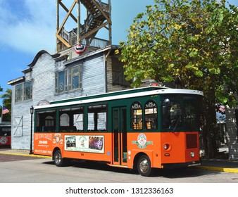 KEY WEST, FLORIDA, USA-FEBRUARY 12, 2019:   A Old Town Trolley Car awaits passengers in front of the Historic Shipwreck Museum in Key West.