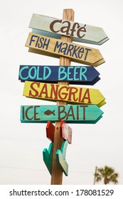 Key West guideposts gives directions for fun and drinks.
