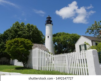The Key West lighthouse  and the keeper's quarters. The lighthouse is a historical attraction in Key West, Florida.